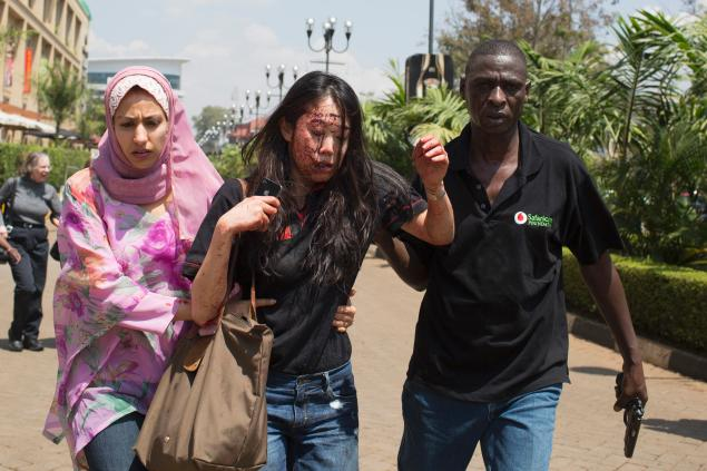 a photo of a friend espcaping westgate {elaine dang, injured by shrapnel}